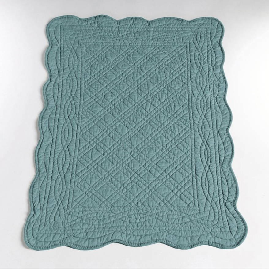 Quilted bedside rug, £20, La Redoute
