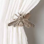 Queen Bee curtain tieback £32, Anthropologie