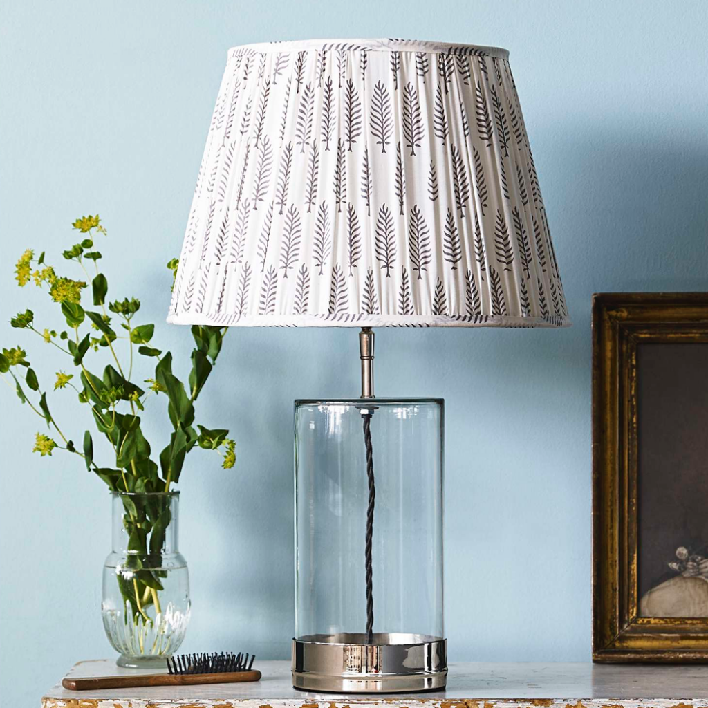 Regular wisteria table lamp base in nickel and clear glass, £165, Pooky