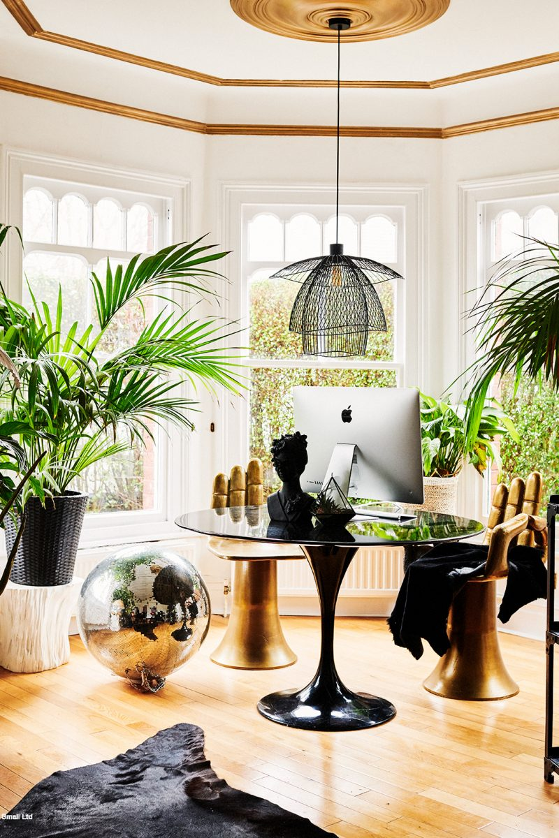 The study of Rockett St George Co'Founder Lucy St George in her North London home with house plants and disco ball. Image by Catherine Gratwicke