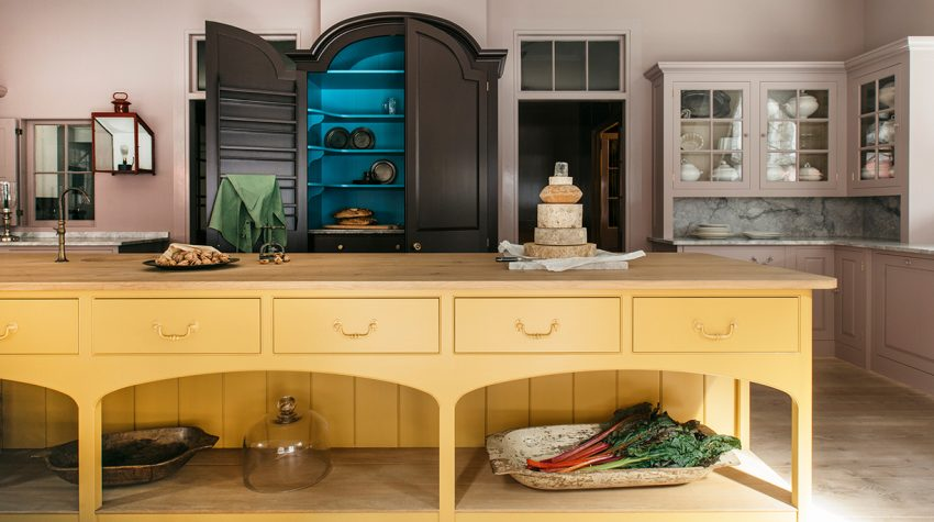 Kitchen island and cabinets Plain English Marylebone showroom showing Rita Konig new paint collection