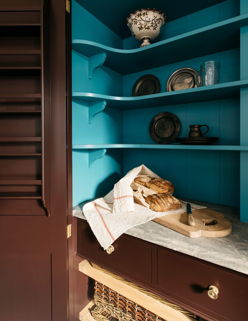 Interior detail of Plain English pantry cupboard painted in Burnt Toast and Tea Caddy from the Rita Konig collection