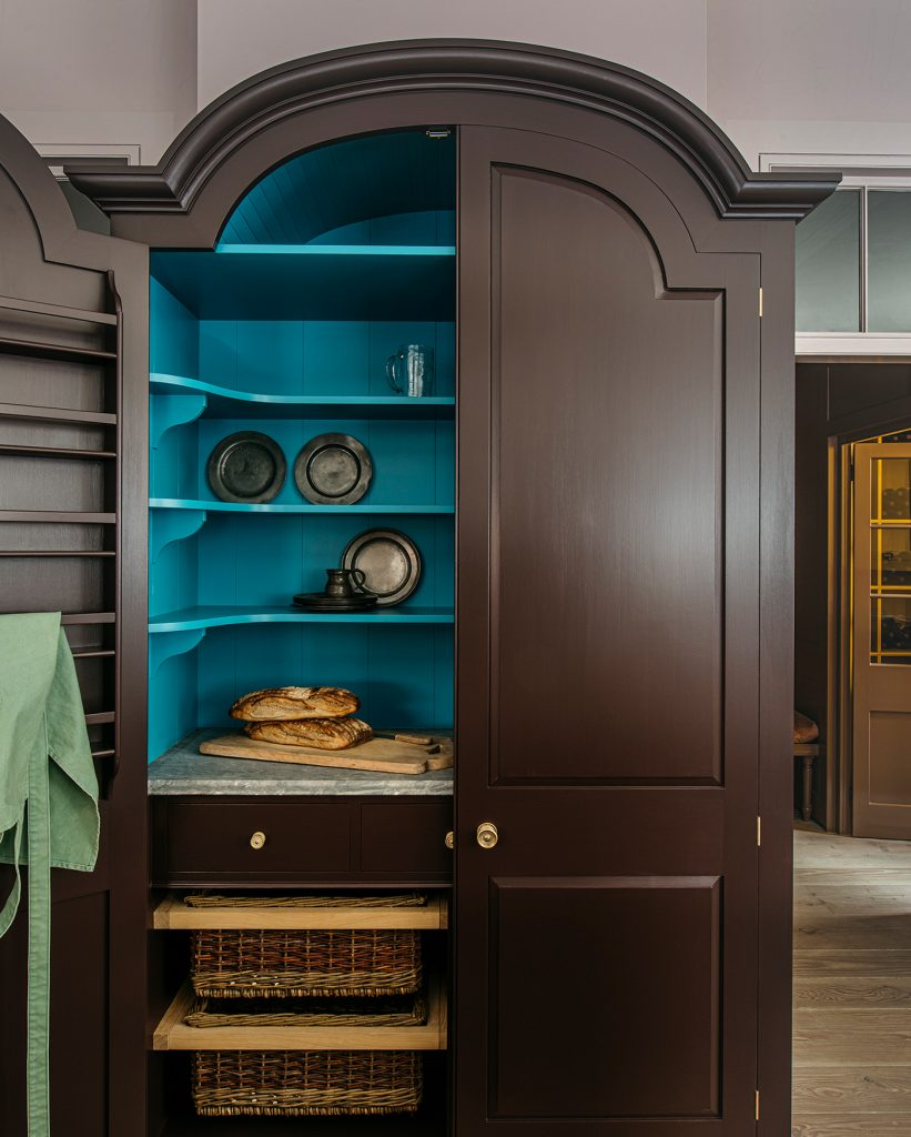 Plain English Marylebone showroom pantry cupboard painted in Burnt Toast and Tea Caddy from Rita Konig's paint collection