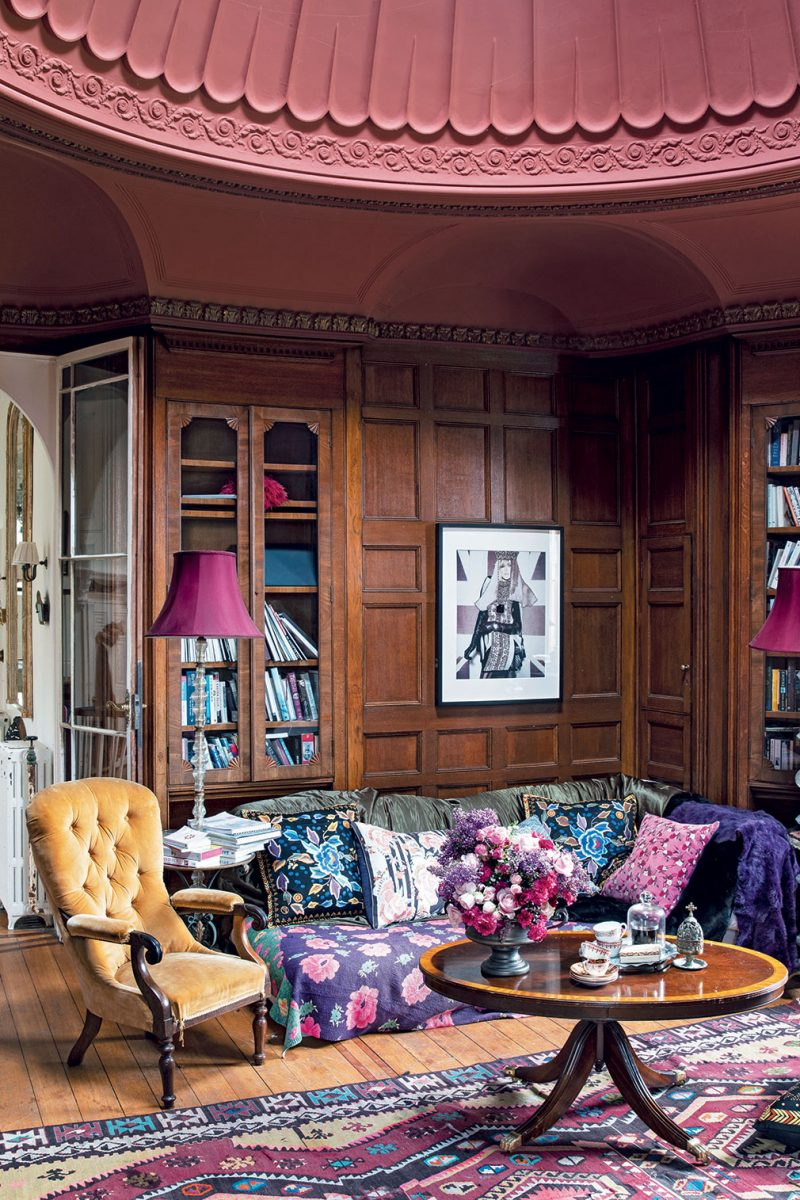 Wood panelling and bold fabrics in the domed library in Alice Temperley's Somerset home