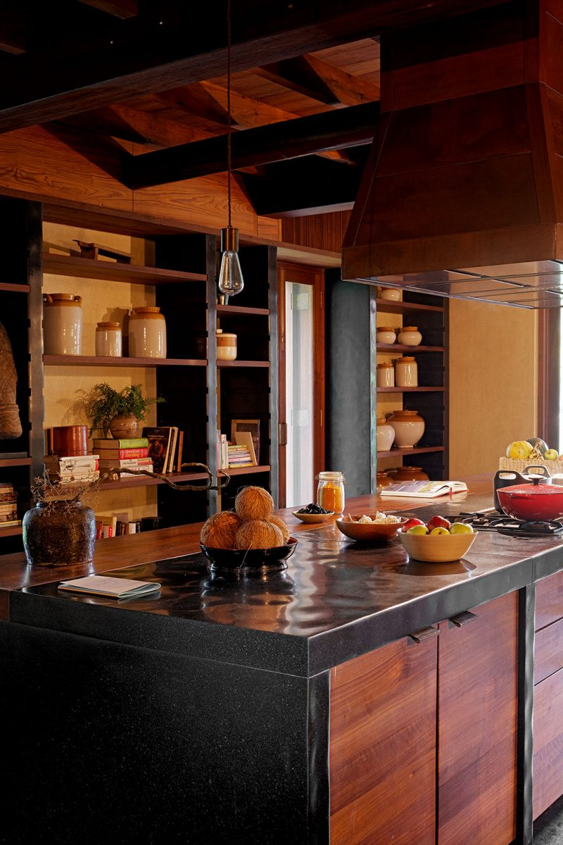 Family kitchen built using granite posts and reclaimed teak in a waterside home in Kerala, India, designed by Axel Vervoordt © Laziz Hamani