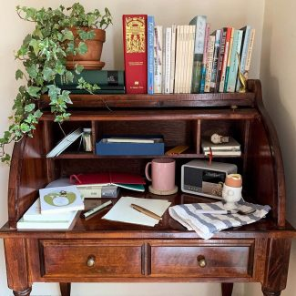 Letter writing desk with ivy plant, books, pen and paper, by Brett Braley-Palko