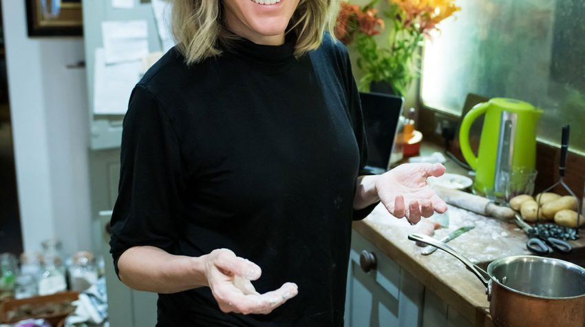 Musician, broadcaster and writer Cerys Matthews cooking in her kitchen at her West London home, by Oli Green