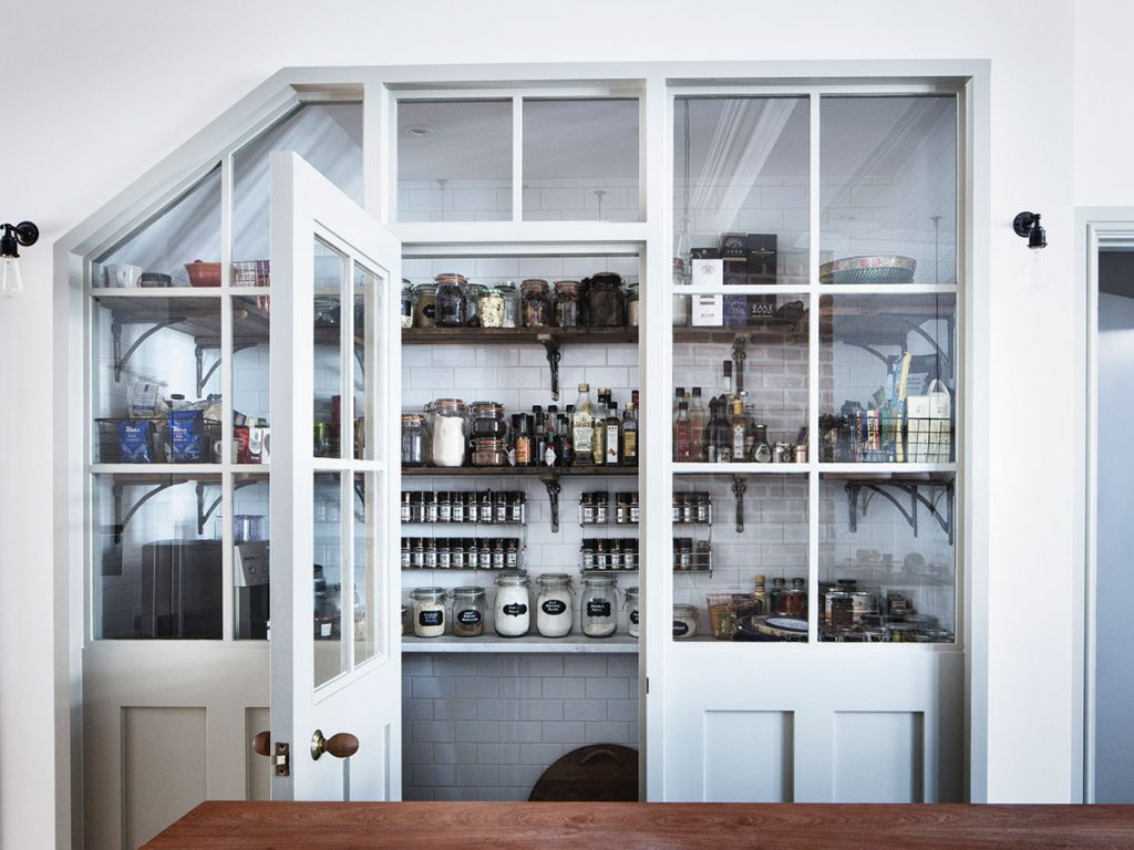 Pantry featuring glass kilner jars with glass walls and doors at the home of Mark Lewis, photograph by Rory Gardiner