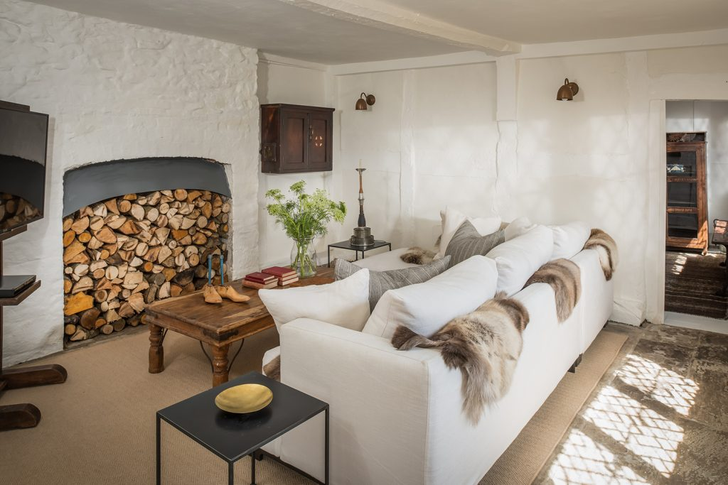 The cosy snug with its white sofa in Hollyhocks, © Unique Homestays, Mark Watts Photography