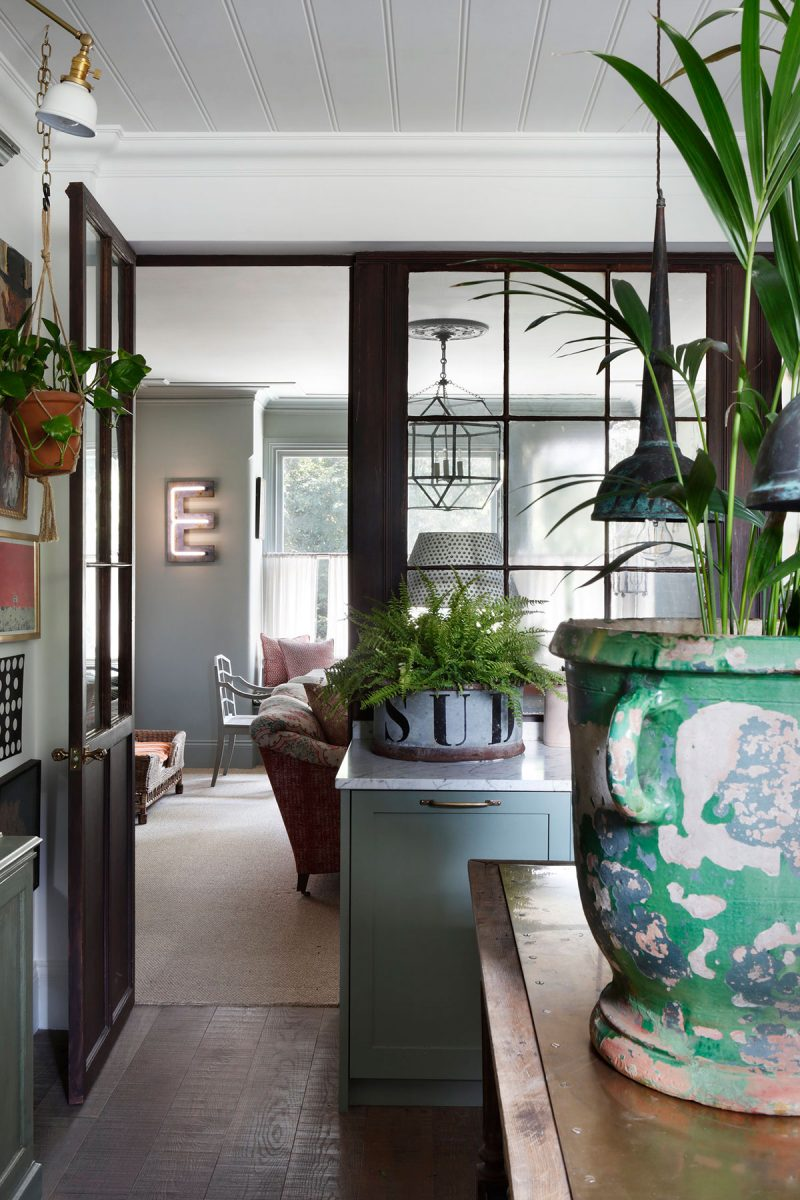 Glass panels dividing kitchen and living room at the home of Tom Cox of ham interiors