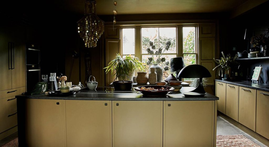 Landscape view of designer Abigail Ahern's kitchen in her East London home, by Herringbone Kitchens