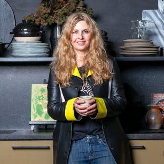 Designer Abigail Ahern in the kitchen at her East London home, by Herringbone Kitchens