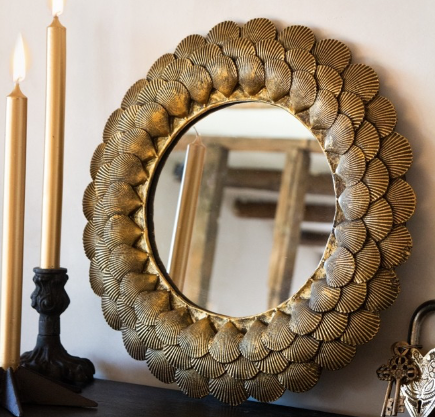 Mirror with antique gold shells, £50, Rockett St George