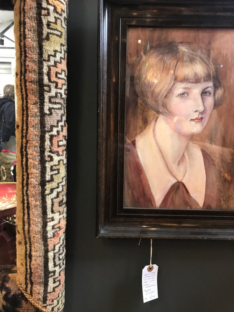 A framed portrait of a woman at Petworth Antiques Market