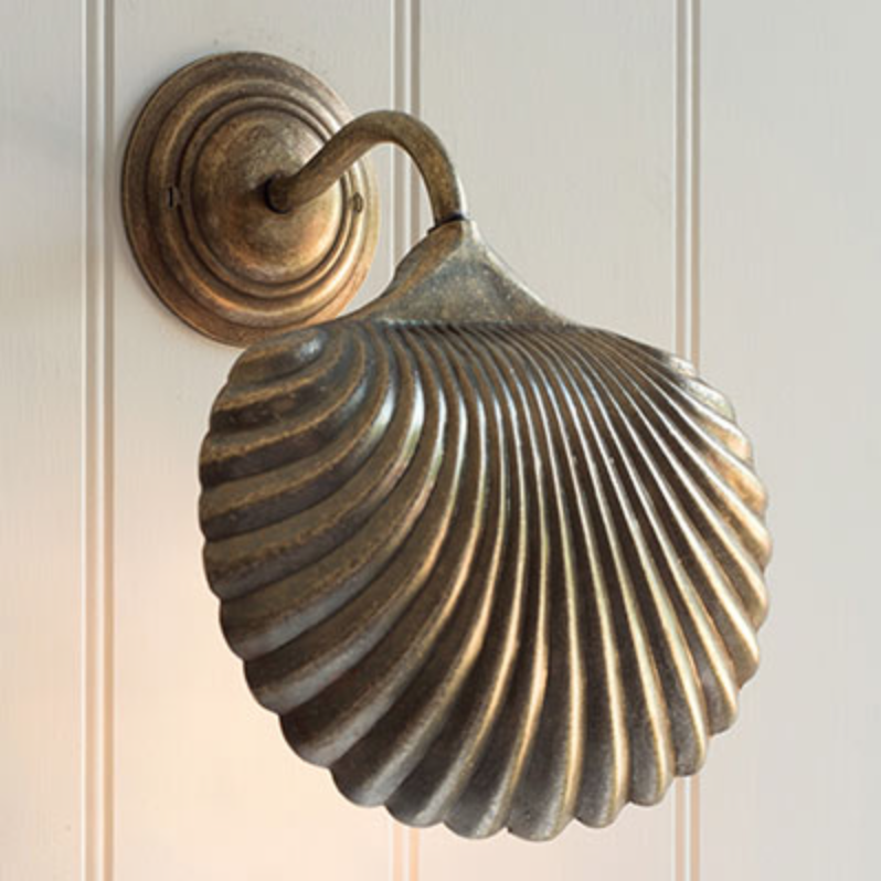 Scallop wall light in antiqued brass, £85.80, Jim Lawrence