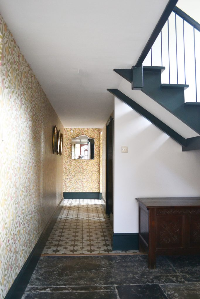 William Morris & Co wallpaper in the hallway at the home of Amy Hemmings-Batt, Founder of Coco and Wolf, Somerset, UK
