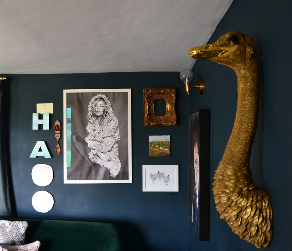 Farrow & Ball Hague Blue walls and eclectic art in the living room of Amy Hemmings-Batt, Founder of Coco and Wolf, Somerset, UK