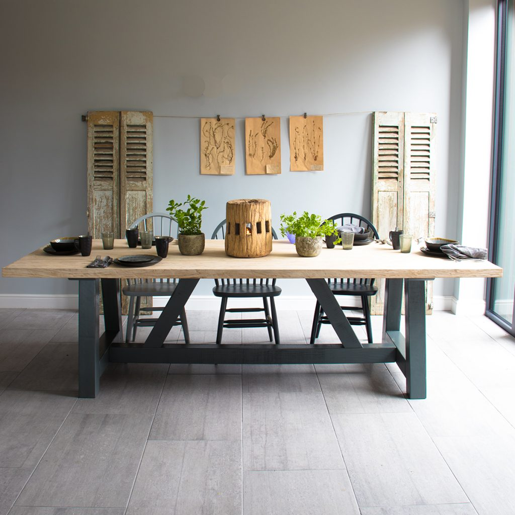 Rustic reclaimed dining table, painted dining chairs, reclaimed shutters and greenery from Home Barn vintage and homeware shop in Marlow, Buckinghamshire