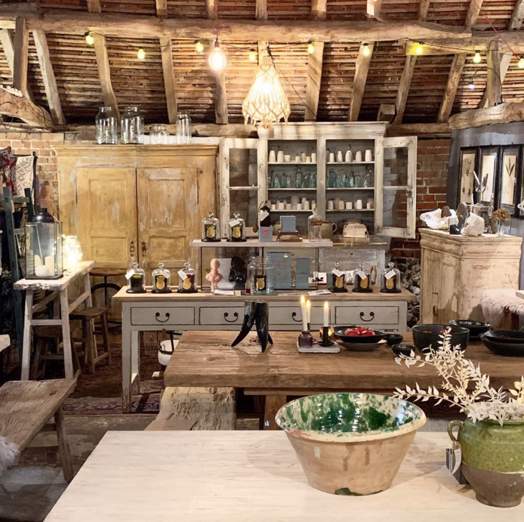 exposed beams, vintage glazed pots, cire trudon candles, antique cabinets at Home Barn vintage furniture and homeware store in Marlow, Buckinghamshire