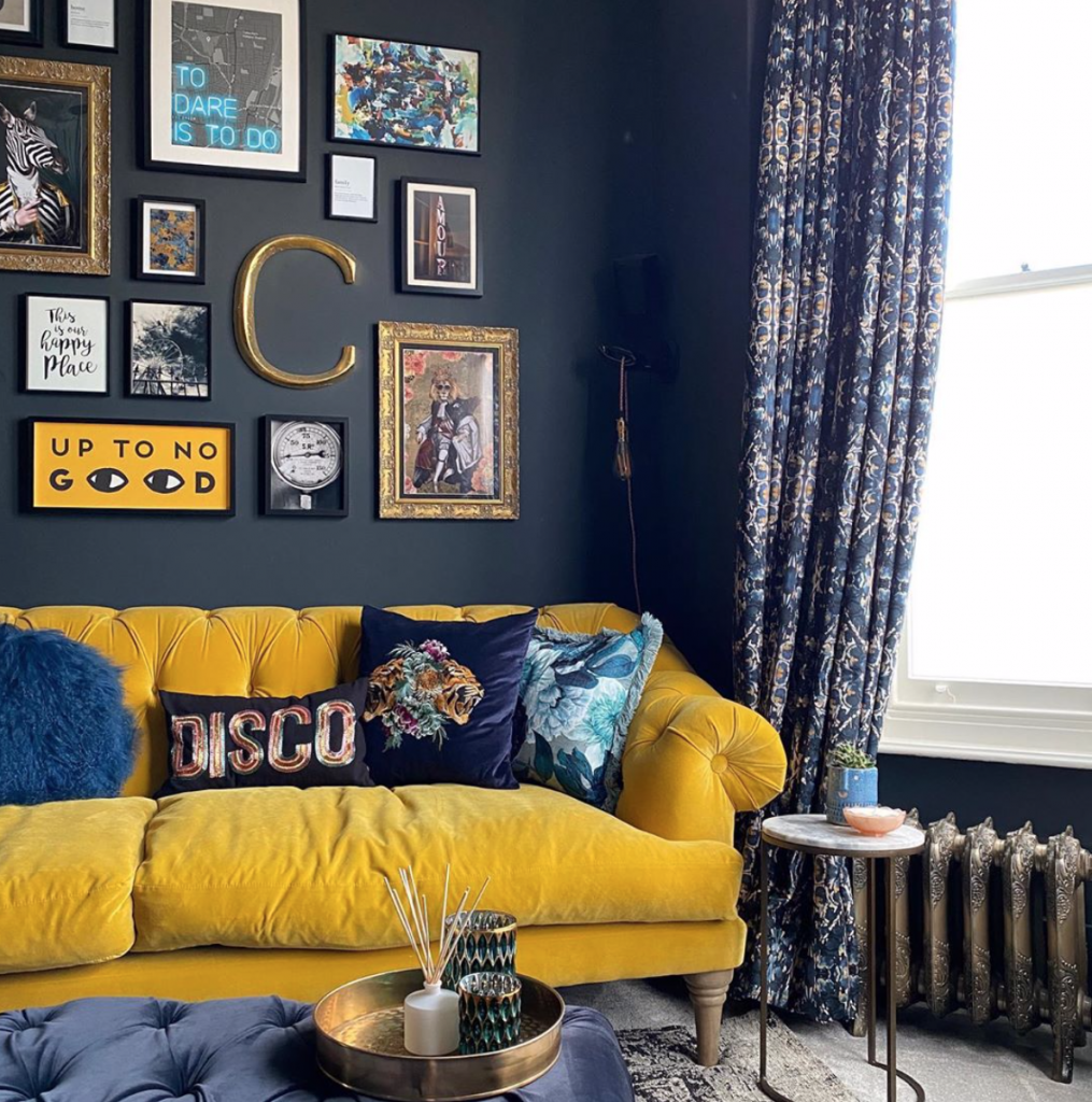 Laura Cave's from living room with yellow Chesterfield sofa and gallery wall restored after the fire 2019