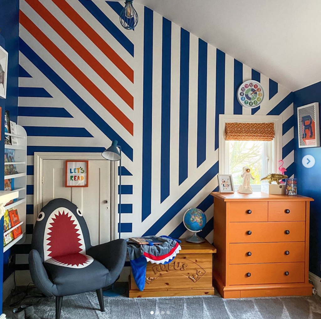Laura Cave's son's bedroom with striped blue, white and red wallpaper and shark chair restored after the fire 2019