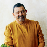 Chef Cyrus Todiwala standing at the kitchen, taken by Matt Russell for the Book Simple Spice Vegetarian