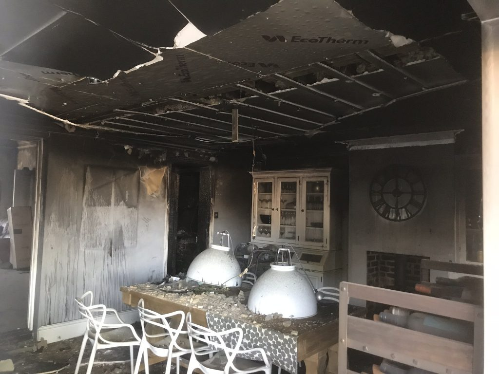 Laura Cave's dining room damaged by the electrical house fire in 2018