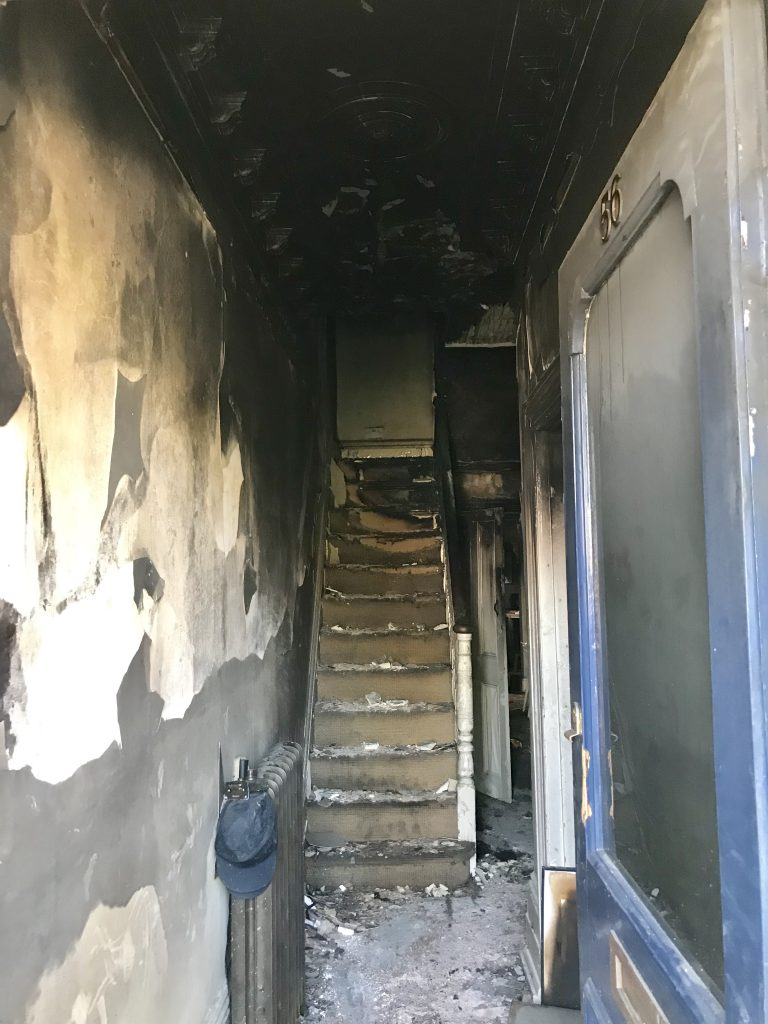 The view from the front door in the home of Laura Cave damaged by a devastating electrical house fire in 2018