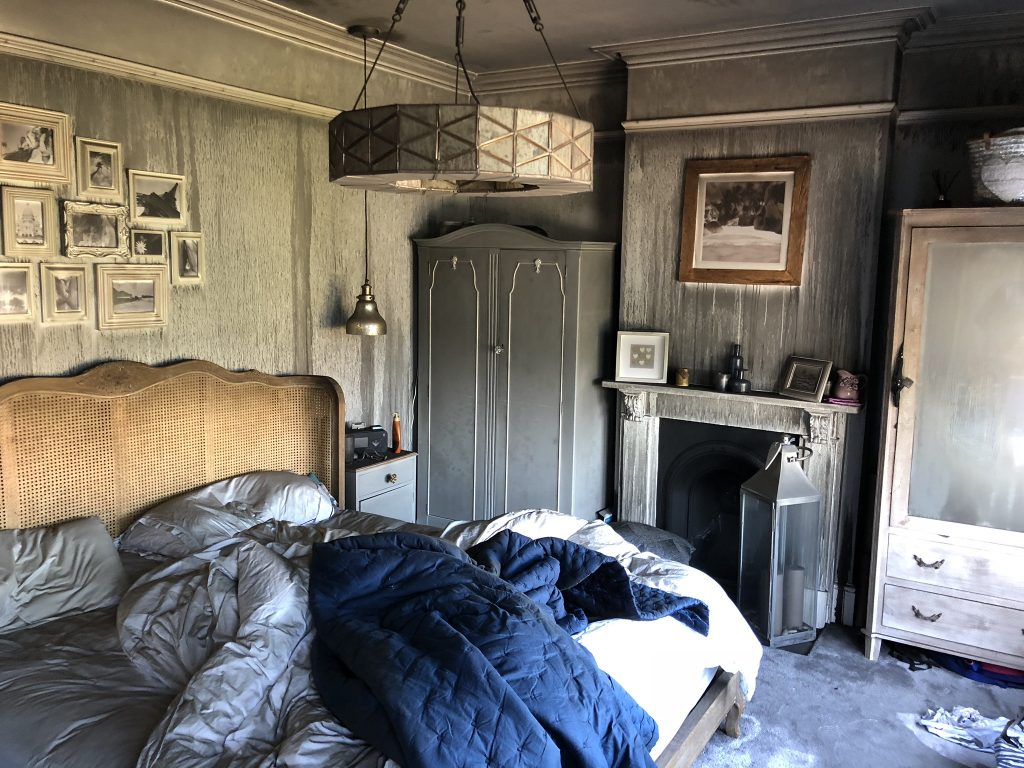 The master bedroom of Laura Cave with smoke damage from the electrical house fire in 2018