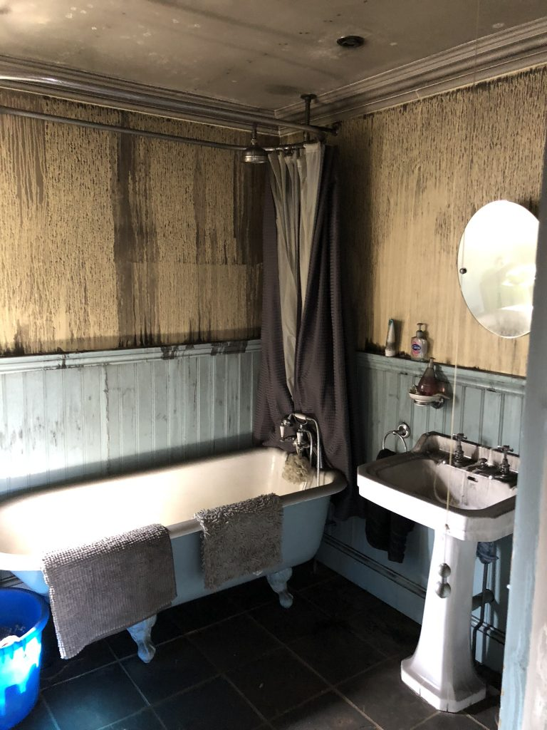 The bathroom of Laura Cave with smoke damage from the electrical house fire in 2018