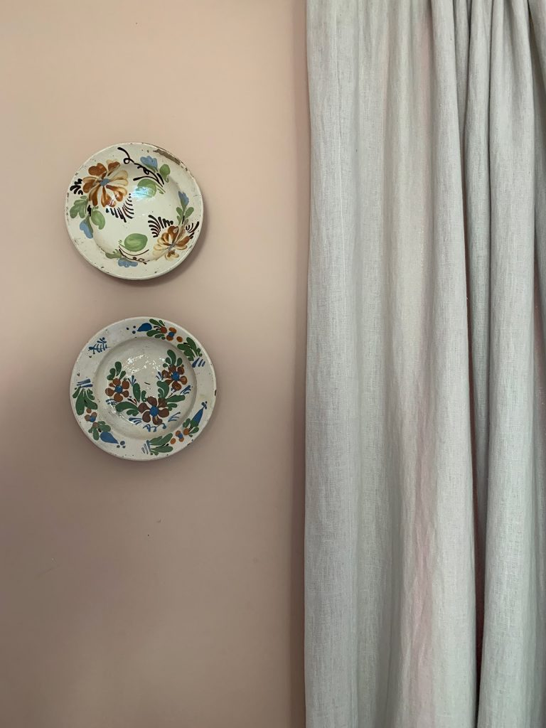 two pretty floral plates hanging on wall in the Cotswolds home of interior designer Victoria Barker, founder of Studio Faeger