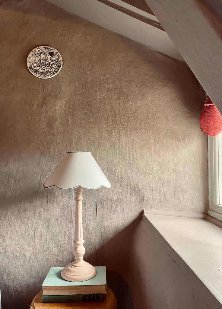 pink table lamp with scallop shade in the Cotswolds home of interior designer Victoria Barker, founder of Studio Faeger