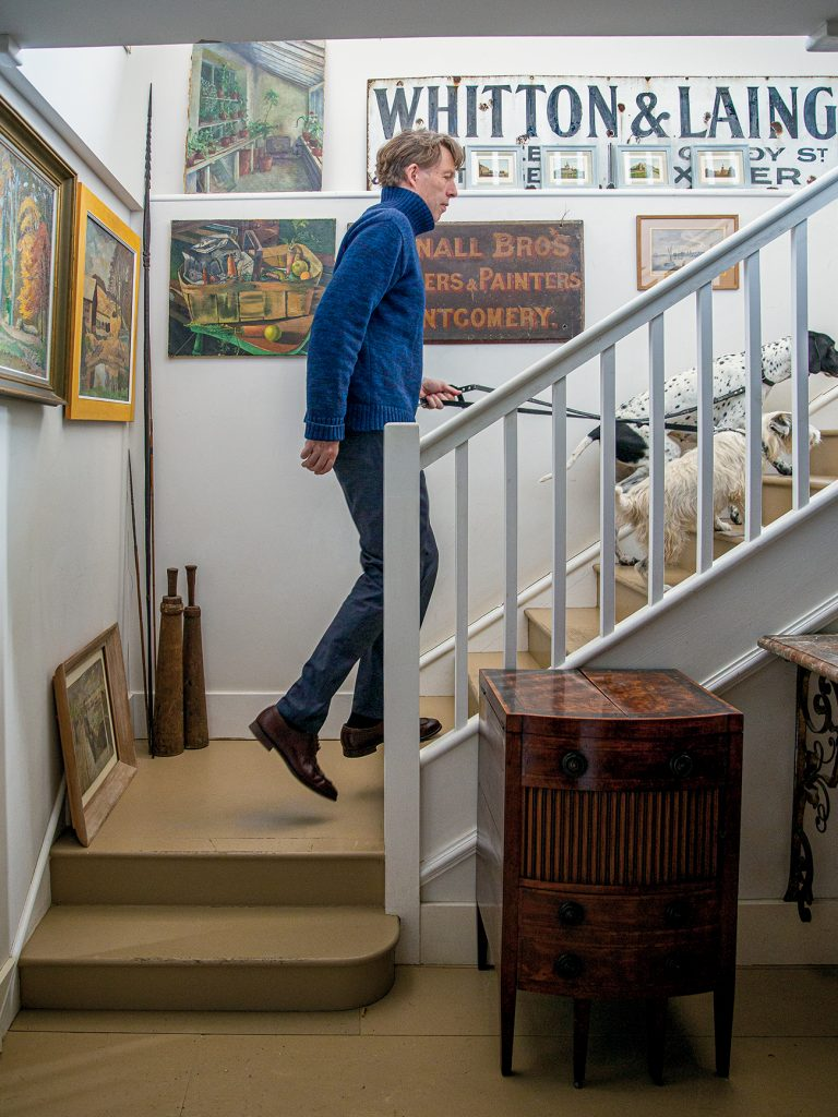 Max Rollitt at home with his dogs from At Home in English Countryside Designers and their Dogs by Susanna Salk © Stacey Bewkes