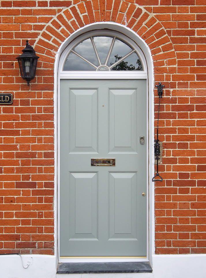 Cotswood-door-spcialists-Georgian-four-panel-front-door with pull bell and fan glass panel