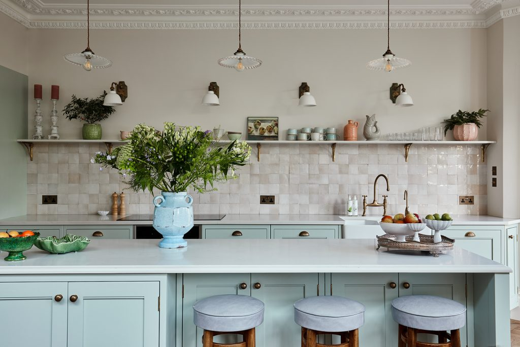 Laura Stephen's kitchen with zeolite tiles antique lighting and cupboards painted in Little Green paint in Mid Aqua © Chris Snook