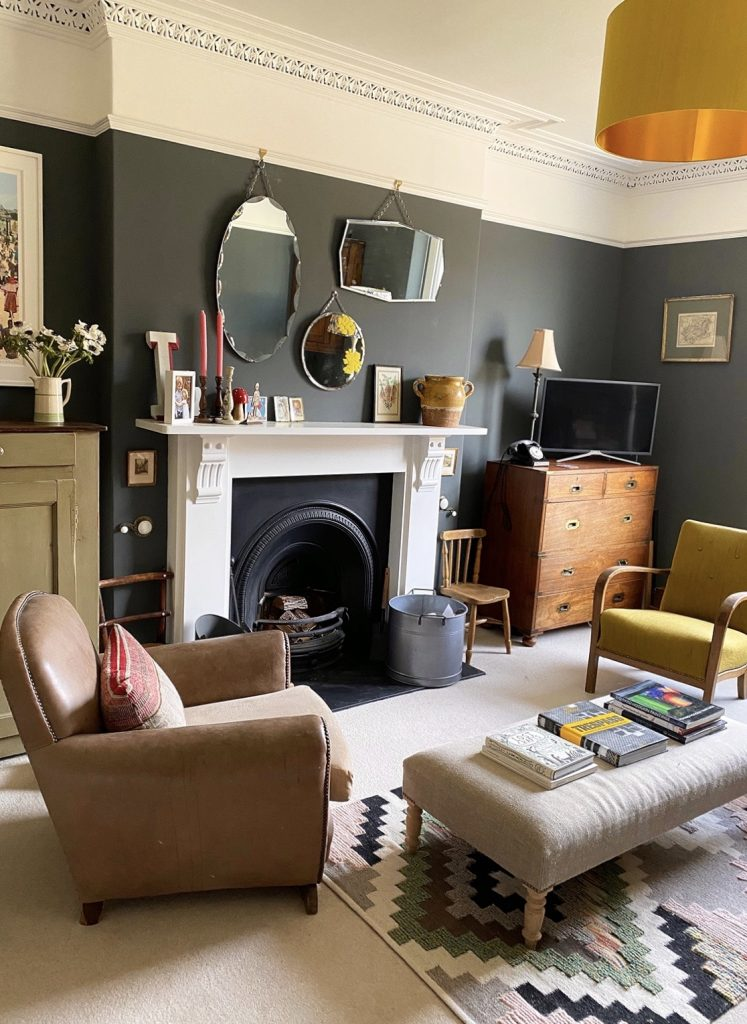 Living room with vintage art and furniture, cornicing, Victorian fireplace, Farrow & Ball Downpipe walls, home of Natalie Williams of Medium Room