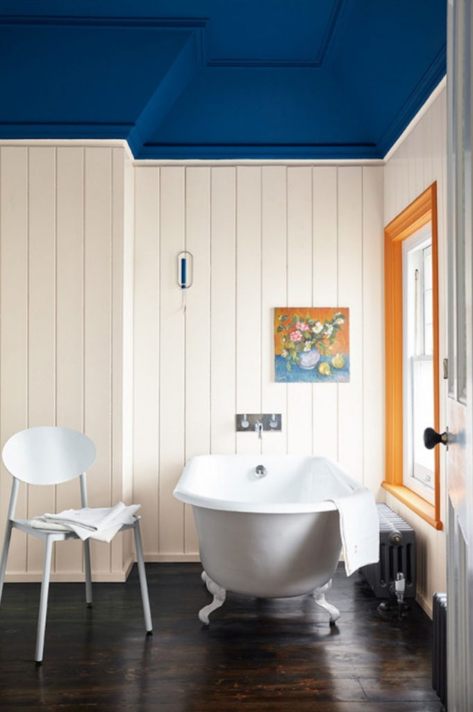Bright bathroom with shiplap white walls, blue ceiling and freestanding bath, Little Greene