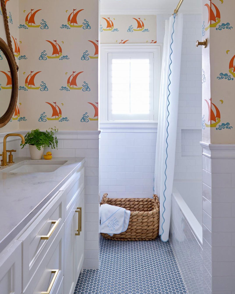 White bathroom with boat print wallpaper and scallop edged shower curtain, designed by Amy Berry, photographer Nathan Schroeder