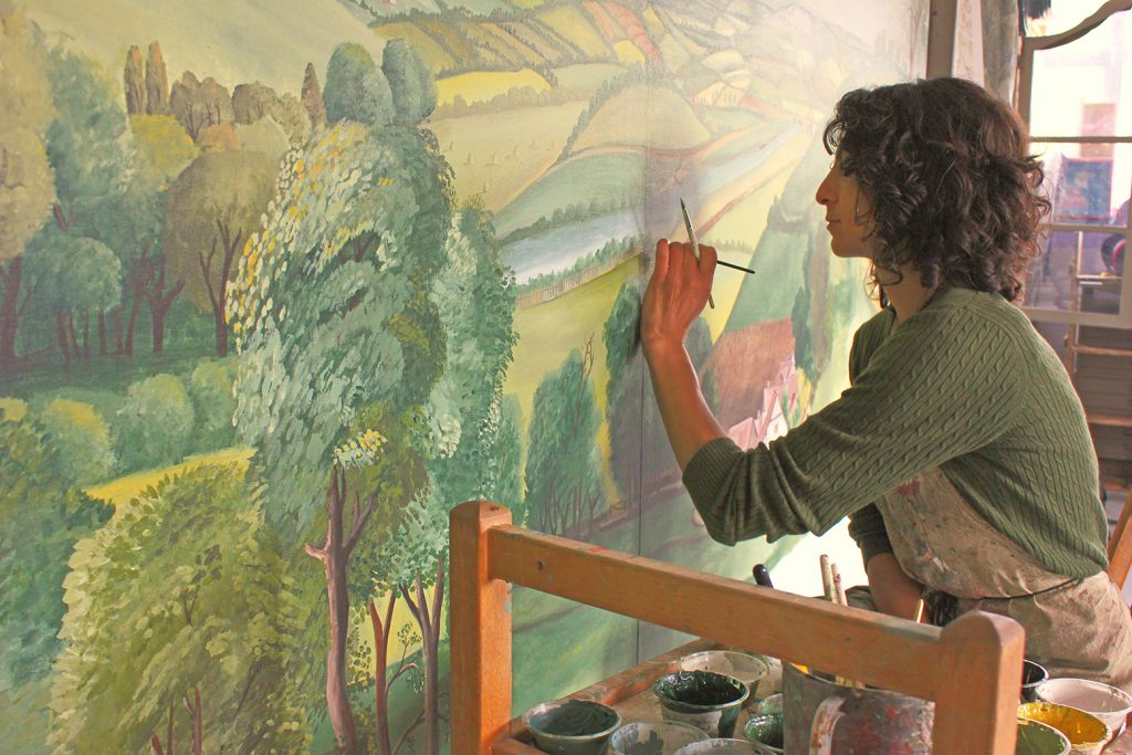 Melissa White painting canvasses for Buckingham Palace mural