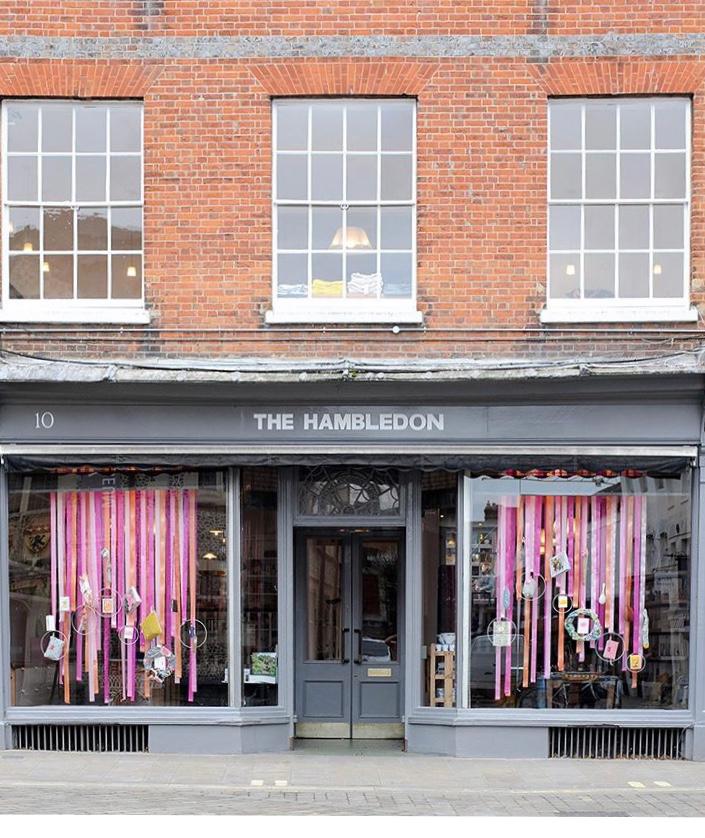 Shop front of The Hambledon lifestyle store in Winchester, featuring colourful ribbon