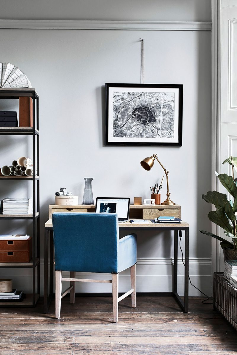 Wooden and metal Carter Desk with angel poise lamp and open shelving in home office with fiddle leaf fig plant, from Neptune