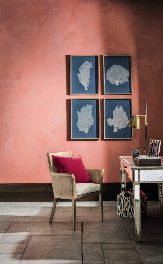 coral pink walls, framed coral prints, cane armchair and desk in home workspace inspiration shot from OKA