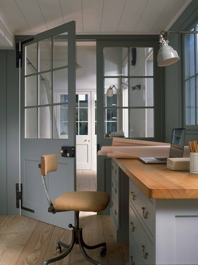Wooden desk area in home office, with grey glazed doors, home office, Plain English