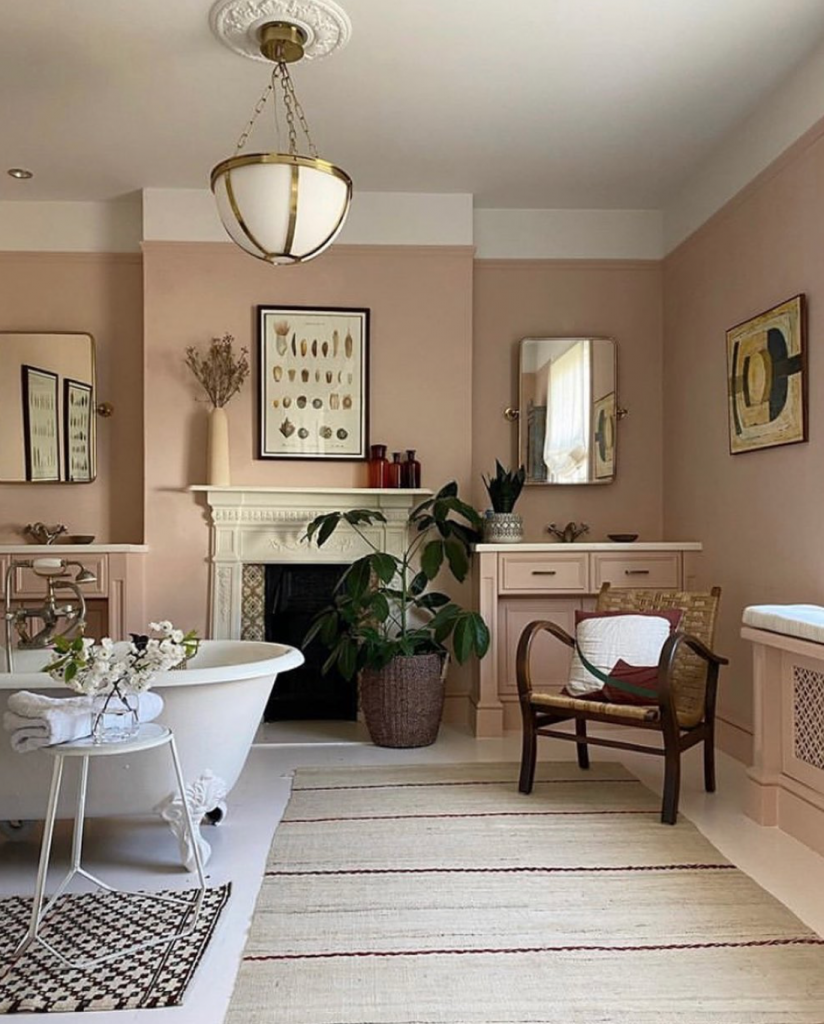 Plaster pink bathroom with freestanding bath and fireplace designed by Anna Haines Design