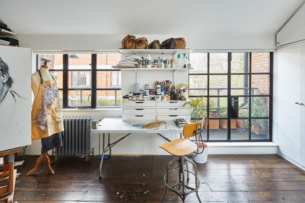 White artist's studio with wooden floor at The Print House in Hoxton, London, for sale from The Modern House