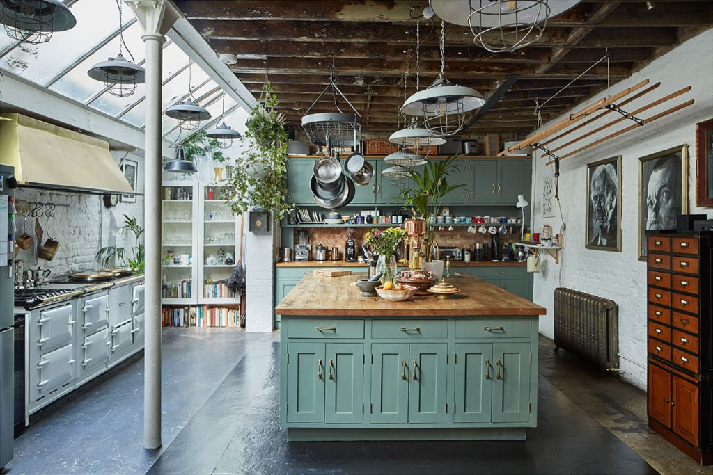 Aquamarine shaker kitchen with wooden worktops, kitchen island, Aga and vintage pendant lights at The Print House in Hoxton, London, for sale by The Modern House