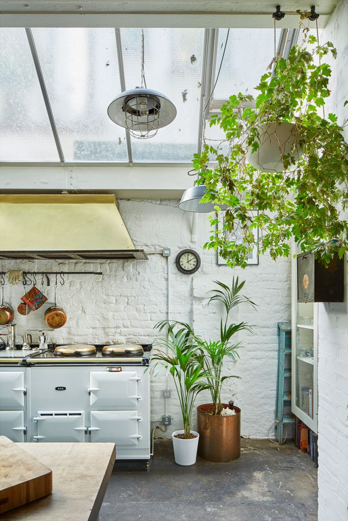 White Aga, stone floor and hanging plant in The Print House in Hoxton, London, for sale by The Modern House