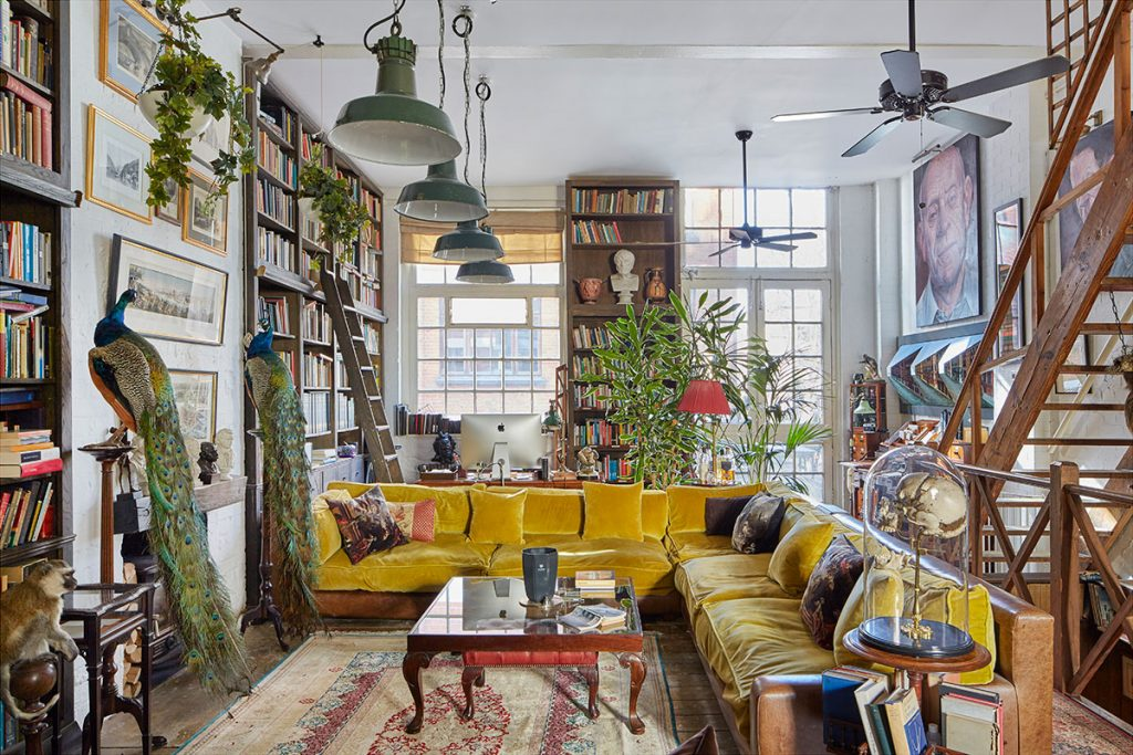 Large mustard yellow l-shaped sofa, wooden staircase, giant vintage pendant lights at The Print House in Hoxton for sale from The Modern House