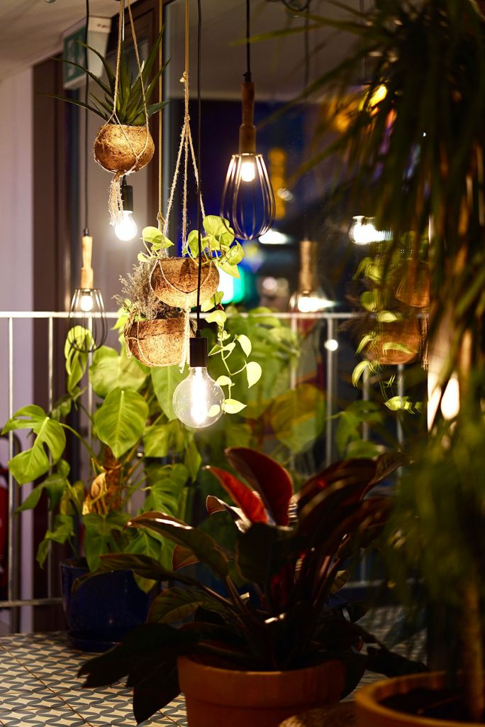 hanging balcony garden lighting by johannes-hofmann-unsplash