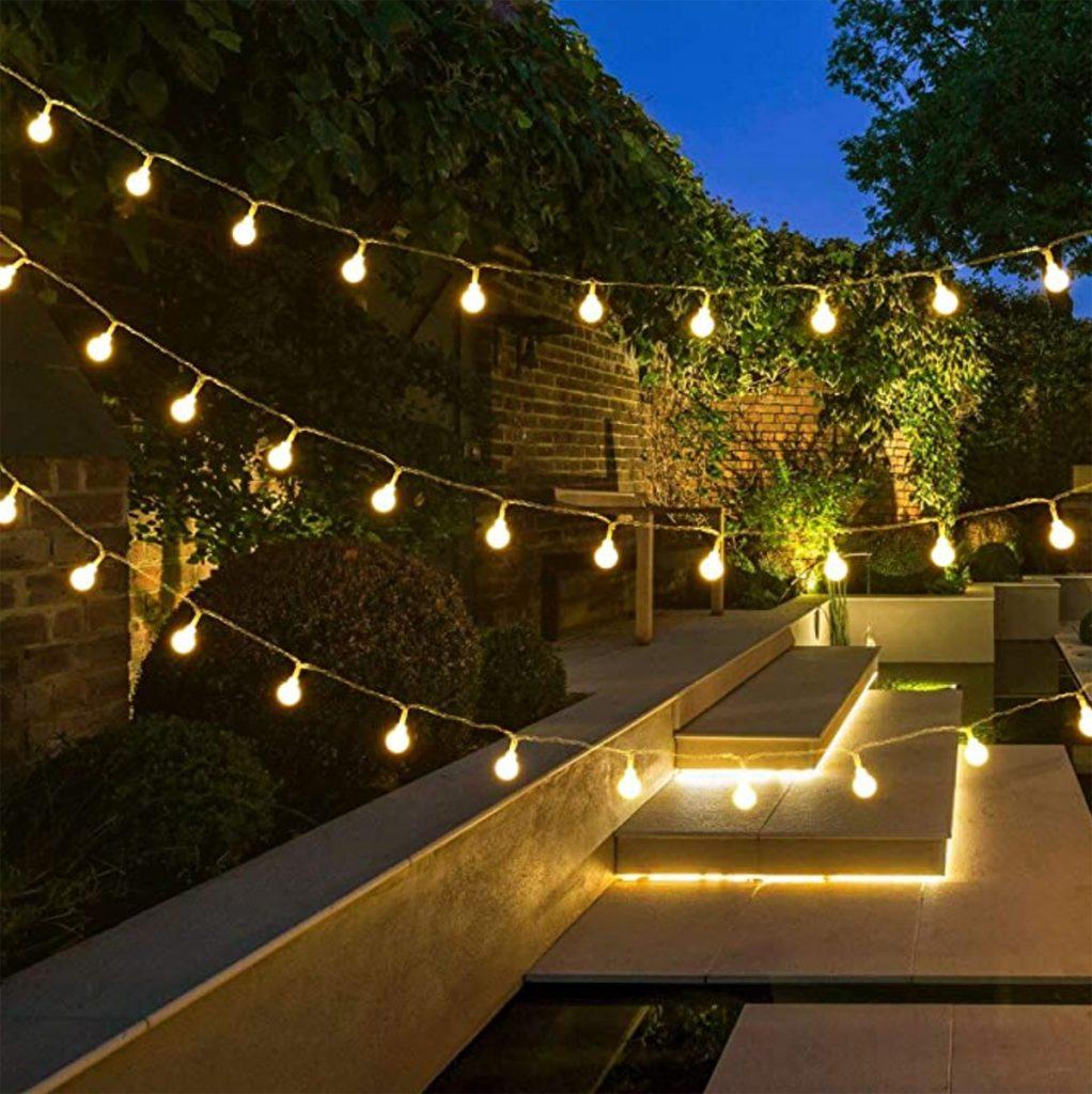 warm white festoon lights and under stairs lights in garden